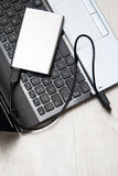 External HDD and laptop Stock Images