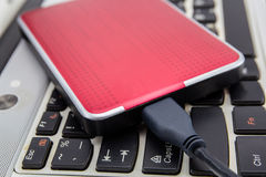 External HDD over notebook keyboard Stock Photography