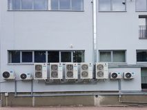 The external part of the air conditioner is located on the wall of the industrial premises. Ventilation device for air refreshment royalty free stock photos