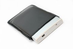 External portable hard disk in leather casing. A small and slim external portable hard disk in leather casing stock photos