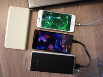 External power Bank for charging smartphones and other devices. Serve to recharge the battery. Details and close-up royalty free stock image
