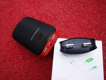 External power Bank for charging smartphones and other devices. Serve to recharge the battery. Details and close-up stock photography