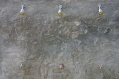 External shower appliance,  outdoor three of showers on cement wall. Stock Photography