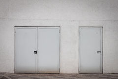 External shut doors on a white wall Stock Images
