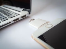 External storage transfering with iPhone and Macbook Royalty Free Stock Photography