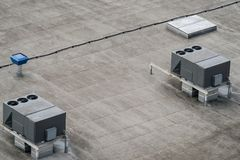 The external units of the commercial air conditioning and ventilation systems. Are installed on the roof of an industrial building Royalty Free Stock Image