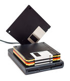 External usb floppy disk drive with disks one standing. External usb floppy disk drive with disks, one standing isolated on white background Stock Photo
