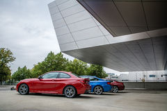 External view of BMW Museum. Diurnal view of the entrance of BMW Museum with cars on display Royalty Free Stock Images