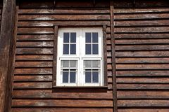 The external window and wall of a vintage wood house in the American West . stock photography