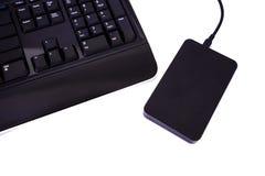 Externe Harde schijven en toetsenbord zwarte kleur Royalty-vrije Stock Afbeelding