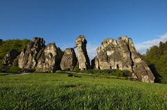 Externsteine. This rock formation is located in the nearing of Horn-Bad Meinberg and Detmold, in Germany. Stairs were carved on the rock, making this the major Stock Photo