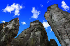 Externsteine upward and blue sky. Externsteine with upward view in front of blue sky with single clouds Royalty Free Stock Photos