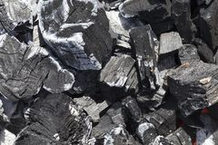 Extinct charcoal. Extinct black charcoal in a fire, close-up photo stock image