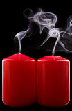 Extinct candle. Two red extinct candles on black Stock Image