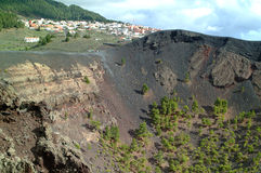 Extinct Volcan at La Palma. A huge crater is left from an extinct volcan in the south of La Palma, an Canarian Island. The trees inside the crater are showing royalty free stock photo