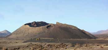 Extinct Volcano. With missing Top due to Eruption Royalty Free Stock Images