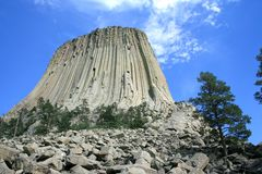 Extinct Volcano. Devil's Tower on the background of blue sky stock photo