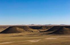 Extinct volcano. Grassland on an extinct volcano royalty free stock photo