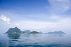 Extinct Volcano Island. Image of remote Malaysian tropical islands that were formerly the rim of a volcano, now extinct stock images