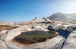 Extinct volcano in Kazakhstan. Extinct volcano and small lake in the desert of eastern Kazakhstan Stock Photos