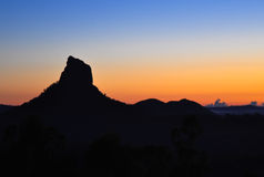 Extinct volcano at sunrise. My Coonowrin, Glasshouse Mountains, Queensland, Australia Royalty Free Stock Images