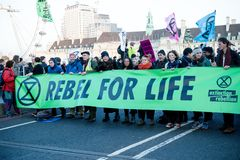 Extinction rebellion protesters on Westminster Bridge, London royalty free stock image