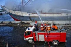 Extinguish the burning ship Royalty Free Stock Photo