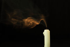 Extinguish the candle and smoke royalty free stock image