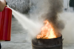 Extinguish a fire Stock Photo