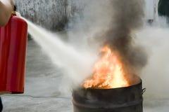 Extinguish a fire Stock Photo