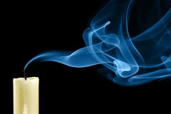 Extinguished candle. With smoke close-up royalty free stock image