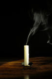 Extinguished candle Stock Photos