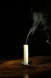 Extinguished candle Stock Photos