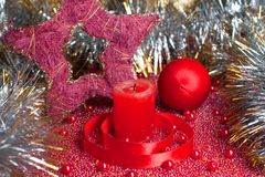 Extinguished candle with christmas decorations Royalty Free Stock Image