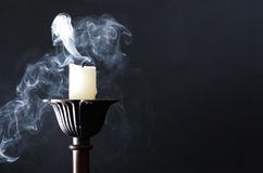 Extinguished Candle On Dark royalty free stock photography