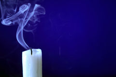 Extinguished Candle On Dark stock images