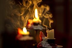 Extinguished Candle. A candle that has burned until the wax drips down and has been extinguished stock photo
