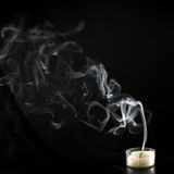 Extinguished candle with smoke royalty free stock photography