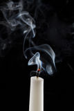 Extinguished candle with smoke. (Metaphor of the death royalty free stock photo