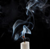 Extinguished candle with smoke. (Metaphor of the death stock photos