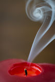 Extinguished candle with smoke Royalty Free Stock Photos