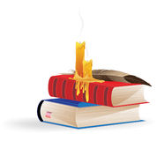Extinguished candles and books Stock Images