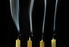 Extinguished candles with smoke Royalty Free Stock Photos