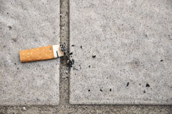Extinguished cigarette. A small cylinder of finely cut tobacco leaves rolled in thin paper for smoking. The cigarette is ignited at one end and allowed to Royalty Free Stock Photos
