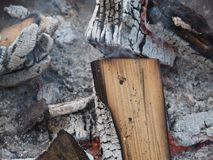 Extinguished fire with wood and ashes. A extinguished fire with wood and ash royalty free stock image