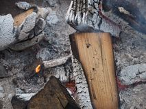 Extinguished fire with wood and ashes. A extinguished fire with wood and ash stock photo