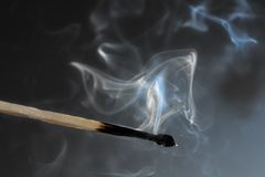Extinguished match. Photo of smoldering match that has just been extinguished Royalty Free Stock Photography