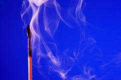 Extinguished Match On Blue Stock Image
