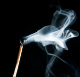 Extinguished the match with smoke Stock Image