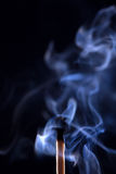 Extinguished match with smoke on black background Royalty Free Stock Image